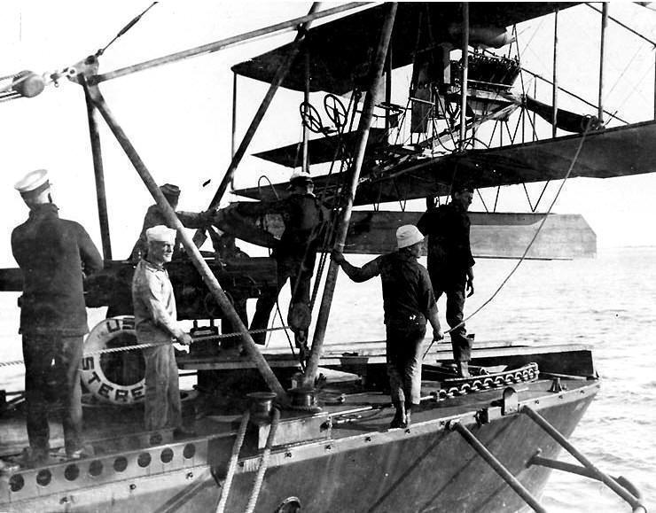 1915 Sterett sailors secure an AH-12 type seaplane on hoist aboard DD-27
